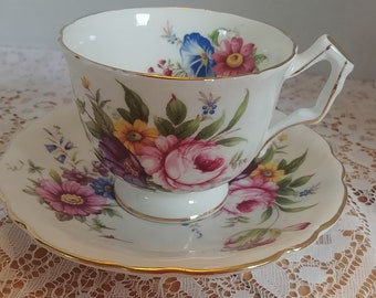 Aynsley Tea Cup and Saucer with Beautiful Pink, Yellow, Blue, and Purple Flowers