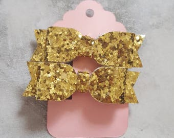 Two tiny gold glitter fabric hair bow clip