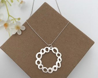 KIRA- dotted circles necklace, round pendant, brushed silver, sterling silver made from metal clay