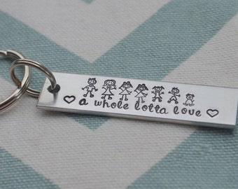 Stick people hand stamped key chain.  A whole lotta love.