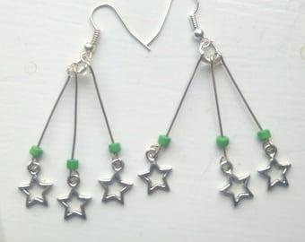 Green star burst earrings