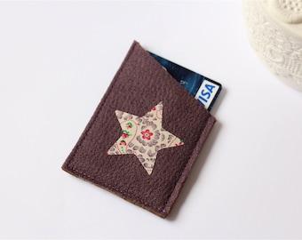 Purple wallet with star flower Center