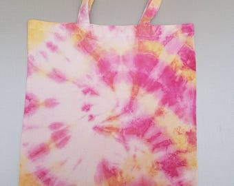 Pink and yellow tie dye tote bag.