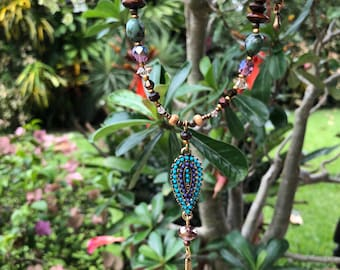 Embellished pendant necklace with crystal, turquoise and wood