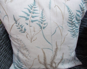 Blue/beige leaf cushion cover, 50cm. Natural linen background with grasses/ferns design.Beige back with envelope closure.  Designer fabric.