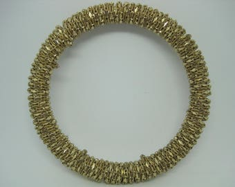 Vintage from the 1970's gold tone snake chain mesh wrapped on bangle bracelet.