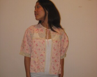 1940's medium size blush pink, with red rose print, bed jacket