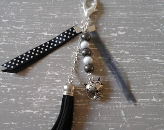 beads and black tassel bag charm