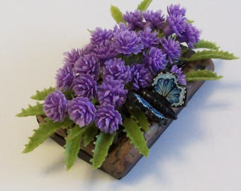 Wood look planter with ferns, purple flowers and a miniature butterfly, for Fairy or miniature gardens and terrariums