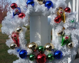 Retro white pine wreath with old fashioned ornaments and multi colored lights