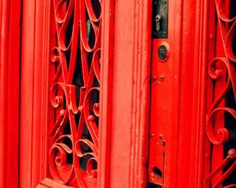 "Rustic red door, intricate iron design, Buenos Aires architecture, Barrio La Boca, wrought iron, ""8x10"""