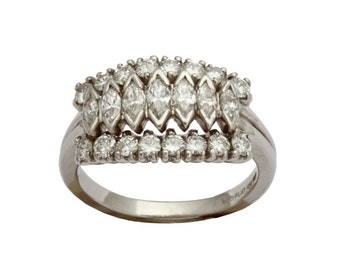 Platinum and diamond band style ring with marquise diamonds in center and round diamonds on either side.