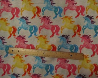 White with Multicolored Unicorns Flannel Fabric by the Yard