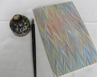 Blue, red and tan hand marbled paper hand sewn notebook