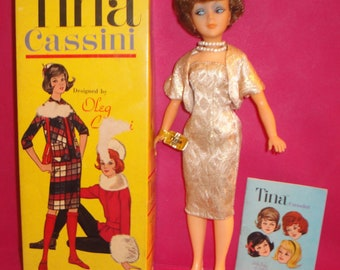 Oleg CassiniDesigned Tina Cassini Doll in Original Outfit, Marked Box, Marked Stand and Booklet