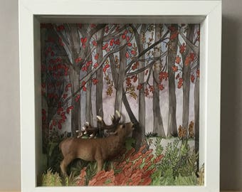 Setting diorama featuring original hand painted and miniature of a deer.