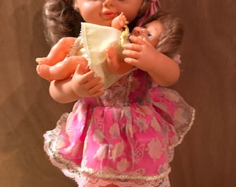 Vintage wind up moving music doll with baby