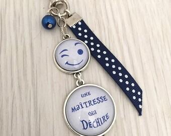 porte-clés bijou de sac a message thème  une maîtresse qui déchire bleu.REF.29