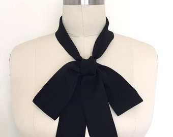 """Silk skinny scarf in black with angled ends is 60"""" x 2"""". Versatile as a sash, choker, headscarf or in a classic bow tie scarf. Unique gift"""