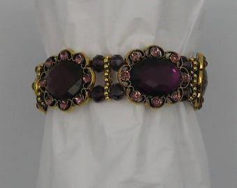 Purple bracelet, antiqued gold tone,glass bead accents,pink rhinestones,elastic