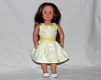 """Lemon yellow with mint green fabrics in this summer dress for an 18"""" doll."""