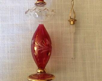 Hand blown ornate glass bottle