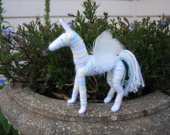 Unicorn- pastel rainbow colored and pose-able
