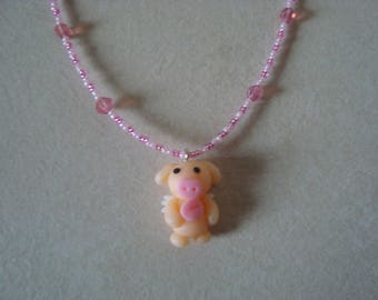 Child necklace with a pig