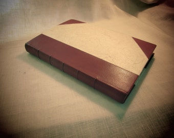 Traditional bookbinding - book repairs - new cover