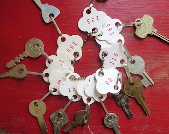 Vintage key tags Numbered key tags White paper key tags Red numbers on tags Paper number tags 12 tags #41