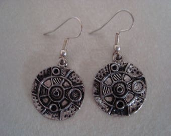 Round earrings featuring a pattern