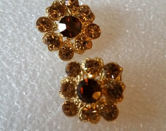 Reduced. Sparkle rhinestone amber colored earrings