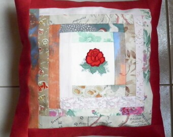 Patchwork cushion with an escutcheon in the Center