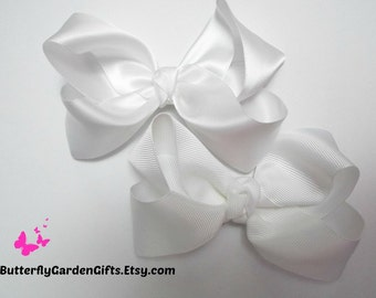 White satin or grosgrain twisted boutique hair bow clip