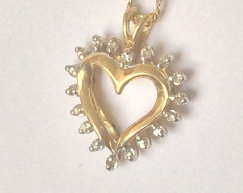 10k gold diamond heart pendant and necklace. #654