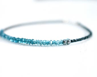 london blue topaz bracelet with black true cut seed beads. black seed bead jewelry. black and blue thin bracelet.  london blue topaz jewelry