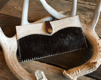 Hair on hide leather clutch