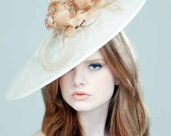 Ivory sinamay asymmetrical hat with nude/natural feathers perfect for wedding or derby/race event