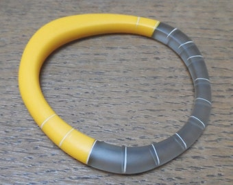 Yellow resin wangle bangle with nude stripes