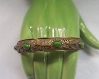 Brass Bangle with Green Glass Stones and Asian Characters