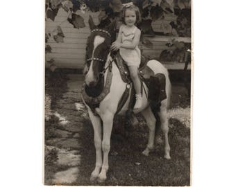 Young girl on a horse 8x10 photo