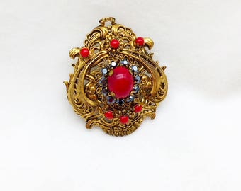 Made in Austria Filigree Brooch with Red Cabachon Stones and Aurora Bourelais Rhinestones