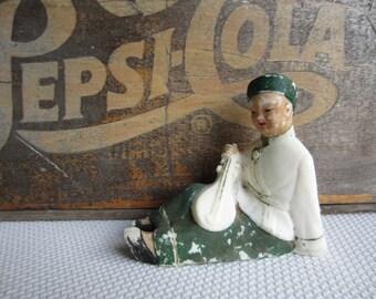 Vintage Asian Man Playing Instrument Figurine