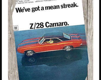 Vintage 1960's Z28 Camero Advertisement on Weathered Wood Background