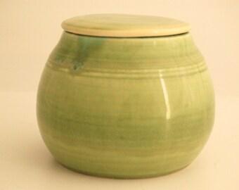 Covered jar,hand thrown porcelain, green glaze with white glaze inside
