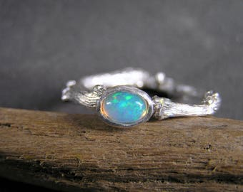 Twig sterling silver ring with fire Ethiopian Opal. Oval flashy fire natural Ethiopian opal. Alternative engagement ring.