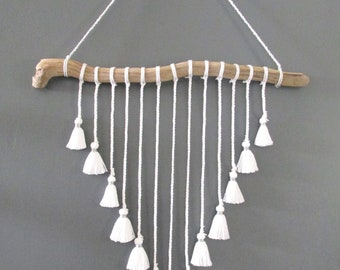 Wall hanging driftwood and white PomPoms