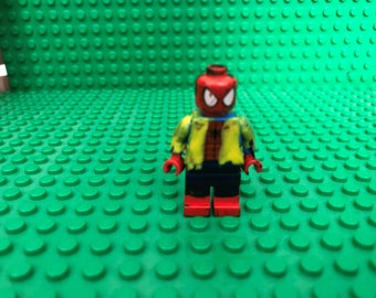 lego spiderman with headphones and jacket
