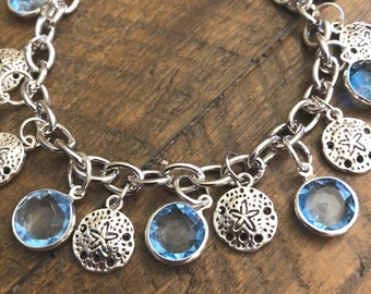 Silver and Blue Starfish Sand Dollar Charm Bracelet on Link Chain w Toggle Clasp