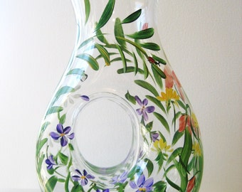 Hand painted glass pitcher with wildflower and fern.